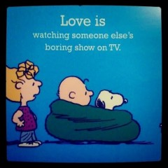 Love is watching some else's boring show on TV